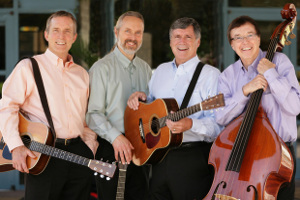 four guys with string instruments