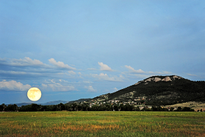 landscape of mountain and harvest moon
